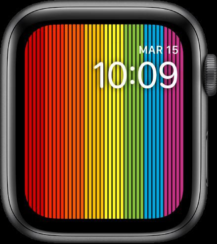 """La carátula """"Orgullo (digital)"""" mostrando tiras verticales arcoíris con la hora en la parte superior derecha."""