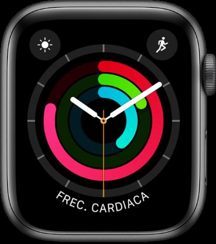 """Carátula """"Actividad - analógico"""" mostrando la hora y el progreso de los objetivos de Moverse, Ejercicio y Pararse. También hay tres complicaciones: Estado del Clima en la esquina superior izquierda, Entrenamiento en la esquina superior derecha, y Frecuencia Cardiaca en la parte inferior."""