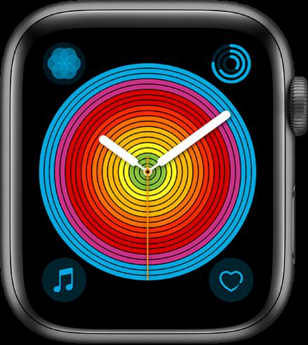 La carátula Orgullo (analógico) usando el estilo circular. Se muestran cuatro complicaciones: Respirar en la esquina superior izquierda, Actividad en la esquina superior derecha, Música en la esquina inferior izquierda y Frecuencia Cardiaca en la esquina inferior derecha.