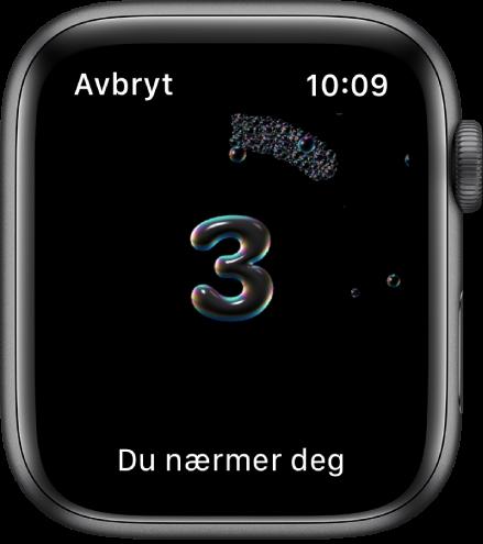Håndvask-skjermen som teller ned fra 3. Ordene «Du nærmer deg» vises nederst.