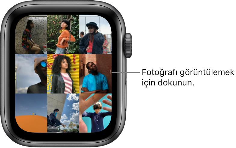 Bir ızgarada görüntülenen çok sayıda fotoğrafla birlikte AppleWatch Fotoğraflar uygulamasının ana ekranı.