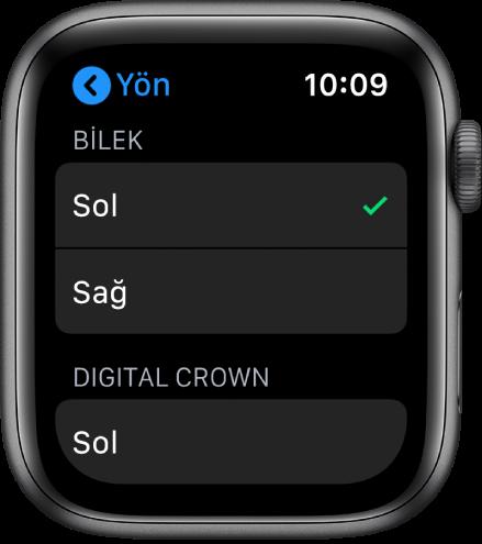 Apple Watch'taki Yön ekranı. Bilek ve Digital Crown tercihinizi ayarlayabilirsiniz.