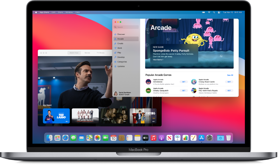 A Mac desktop with the Apple TV app showing The Watch Now screen and the App Store app showing Apple Arcade.
