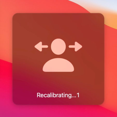 """The onscreen countdown for head pointer recalibration, showing """"Recalibrating…1""""."""