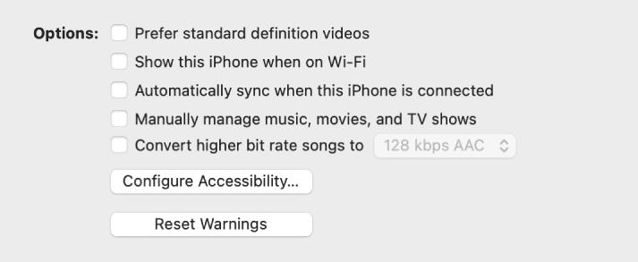 Les options de synchronisation affichant des cases à cocher permettant de gérer manuellement des éléments de contenu, de synchroniser automatiquement et d'afficher l'appareil lorsqu'il est connecté via Wi-Fi. Les options «Préférer les vidéos en définition standard» et «Convertir les morceaux dont le débit est supérieur en» s'affichent également. Les boutons «Configurer l'accessibilité» et «Réinitialiser les avertissements» s'affichent également.