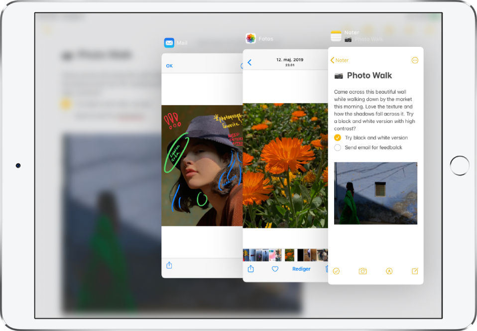 Tre apps åbne i Slide Over-vinduer.