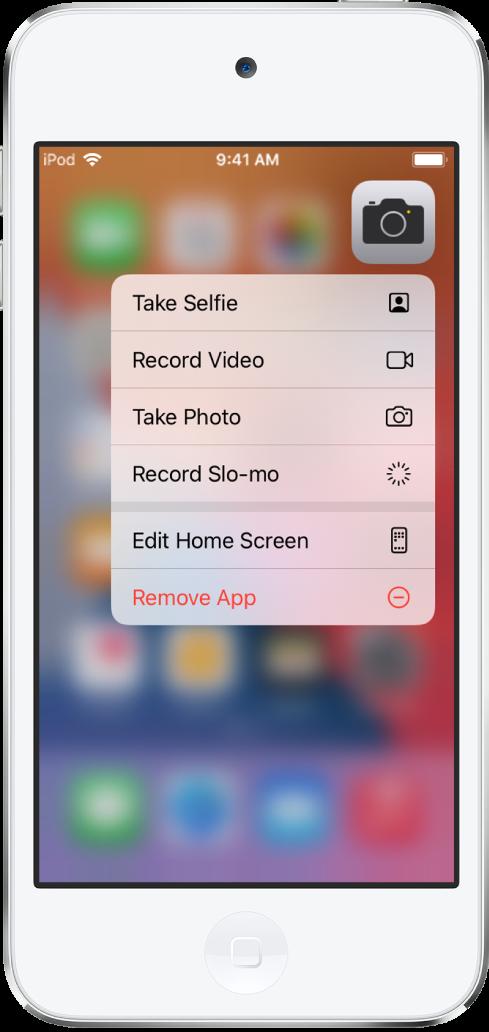 """Im Hintergrund befindet sich der weichgezeichnete Home-Bildschirm mit dem Menü für Kamera-Schnellaktionen unter der App """"Kamera""""."""