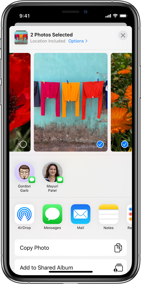 The Sharing screen with photos across the top; two photos are selected, indicated with a white checkmark in a blue circle. The row beneath the photos shows friends you can share with using AirDrop. Below that are other sharing options, including, from left to right, Messages, Mail, Shared Albums, and Add to Notes. In the bottom row are the Copy, Copy iCloud Link, Slideshow, AirPlay, and Add to Album buttons.
