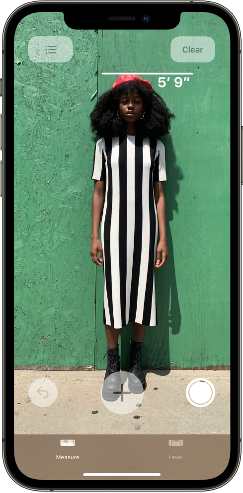 A person's height is measured, with the height measurement showing at the top of the person's head. The Take Picture button is active on the right edge for taking a picture of the measurement. The green Camera In Use indicator appears at the top right.
