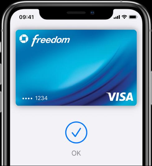 """Um cartão de crédito na tela da Wallet. Abaixo do cartão, encontra-se uma marca de verificação e a palavra """"OK""""."""