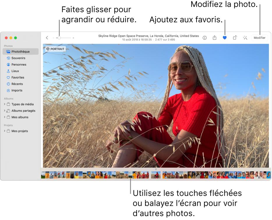 La fenêtre Photos présentant une photo agrandie à droite avec un rang de vignettes au-dessous. La barre d'outils en haut comprend le curseur Réduire/agrandir, le bouton Ajouter aux favoris et le bouton Modifier.