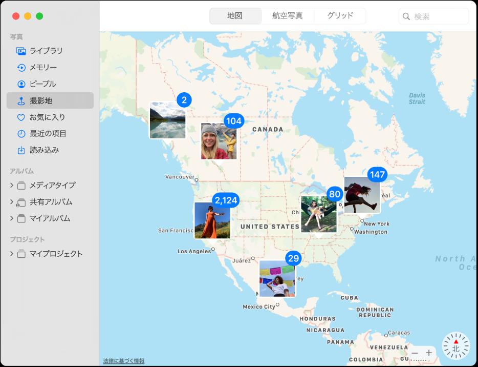 写真のサムネールが場所ごとに分類されて地図上に表示されている「写真」ウインドウ。