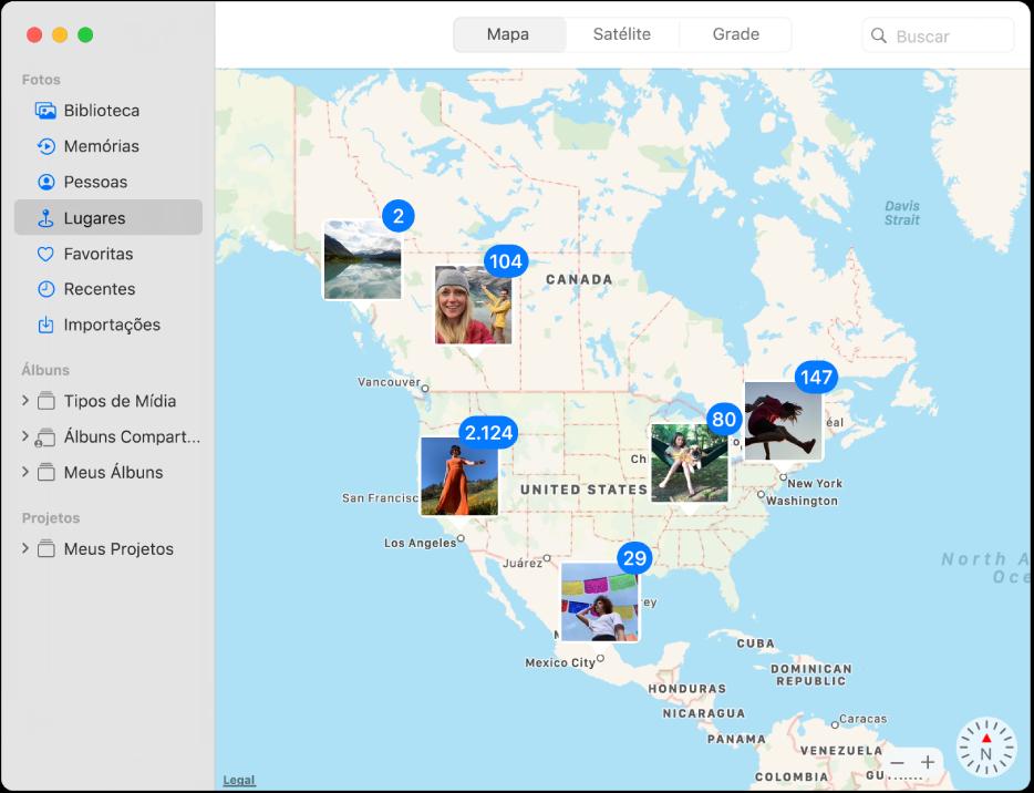 A janela do Fotos exibindo um mapa com miniaturas de fotos agrupadas por localização.