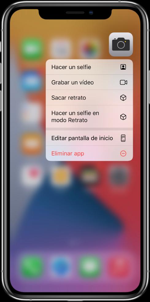 Pantalla de inicio borrosa con el menú de acciones rápidas de la app Cámara debajo de la app.