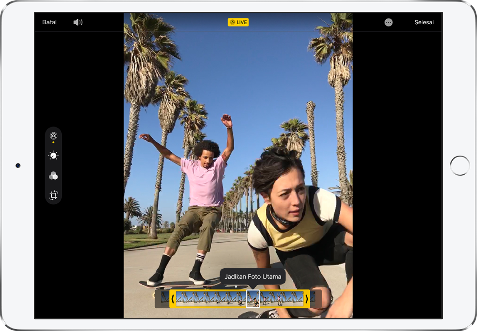 Live Photo dalam mod Edit. Di sebelah kiri skrin, butang Langsung dipilih. Foto berada di tengah skrin dan bingkai Live Photo dipaparkan di bawahnya. Bingkai Foto Utama yang dipilih bergaris kasar dengan warna putih; pilihan Jadikan Foto Utama muncul di atas bingkai.