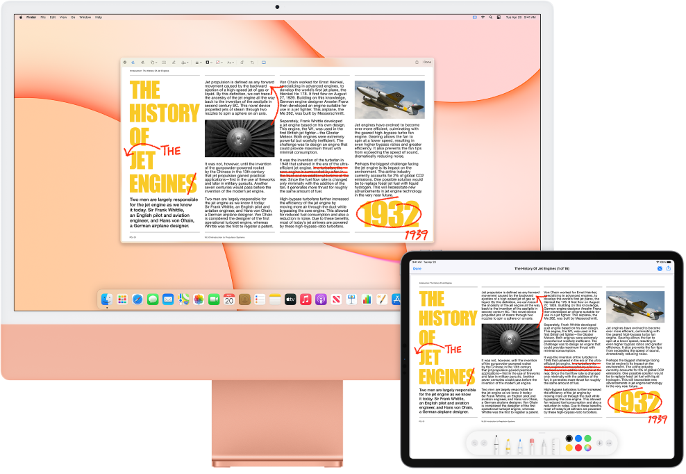 An iMac and an iPad sit side by side. Both screens display an article covered in scribbled red edits, such as crossed out sentences, arrows, and added words. The iPad also has mark up controls at the bottom of the screen.