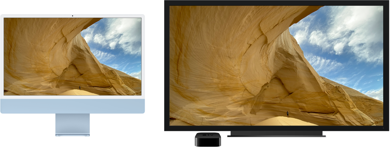 An iMac with its content mirrored on a large HDTV using an AppleTV.