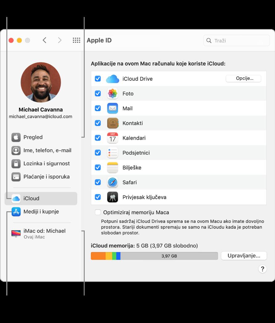 Prozor Apple ID-ja u Postavkama sustava. Kliknite stavku u rubnom stupcu za ažuriranje podataka o računu, uključite ili isključite iCloud, upravljajte medijskim računima i pregledajte sve uređaje na koje ste prijavljeni koristeći svoj Apple ID.