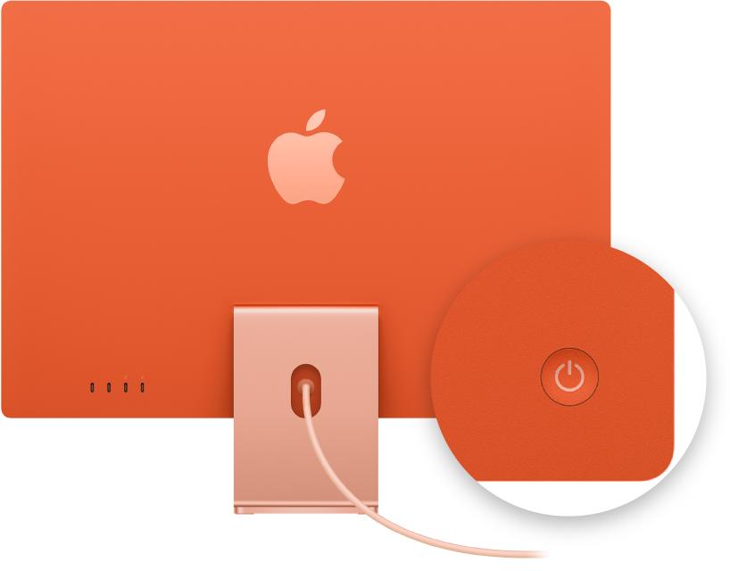 Vista traseira de um iMac com ênfase no botão de força.