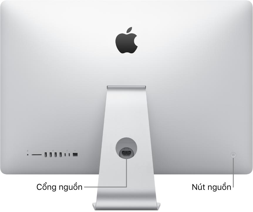 Góc nhìn phía sau của iMac đang hiển thị dây nguồn và nút nguồn.