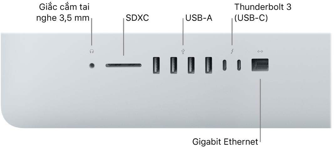 Một iMac đang hiển thị giắc cắm tai nghe 3,5 mm, khe cắm SDXC, các cổng USBA, các cổng Thunderbolt3 (USB-C) và cổng Gigabit Ethernet.