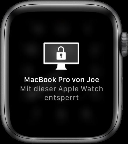 """Display der AppleWatch mit der Nachricht """"Joes iMac Pro von dieser AppleWatch entsperrt""""."""