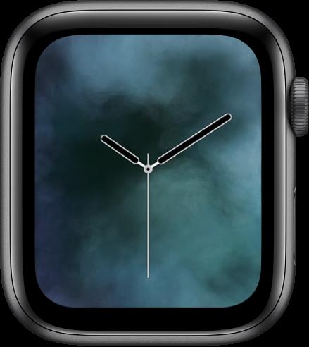 """Das Zifferblatt """"Nebel"""" zeigt eine analoge Uhr in der Mitte umgeben von Nebel."""