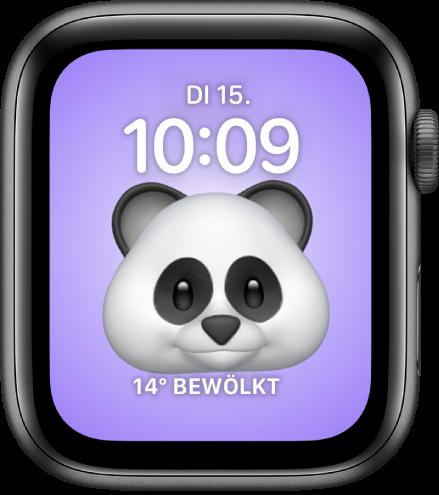 """Das Zifferblatt """"Memoji"""", auf dem du die Memoji-Figur anpassen kannst. Unten befindet sich eine Komplikation. Tippe auf das Display, um das Memoji zu animieren. Datum und Uhrzeit werden oben angezeigt und die Komplikation """"Wetter"""" befindet sich unten."""