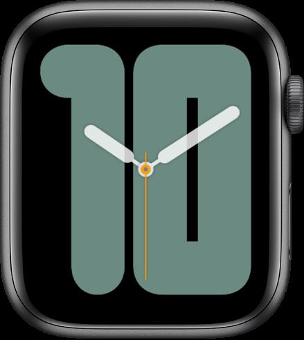 Wajah jam Angka Mono menampilkan jarum analog di atas angka besar, menunjukkan tanggal.