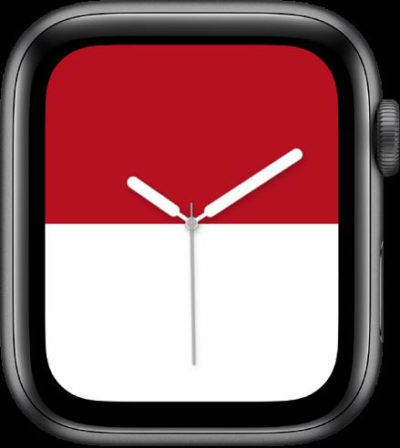 Wajah jam Belang menampilkan garis merah tebal di bagian atas dan garis putih tebal di bagian bawah.