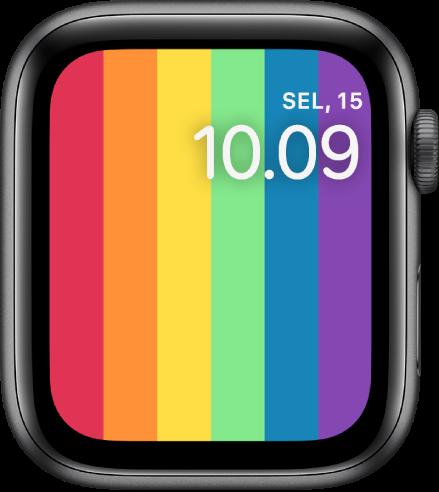 Wajah jam Pride Digital menampilkan garis pelangi vertikal dengan tanggal dan waktu di kanan atas.