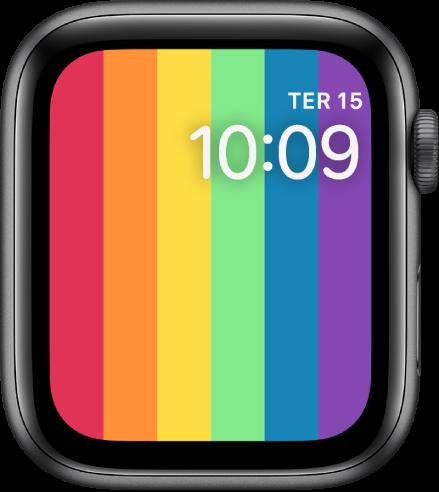 Mostrador Orgulho Digital exibindo as listras verticais do arco-íris com o dia e a hora na parte superior direita.