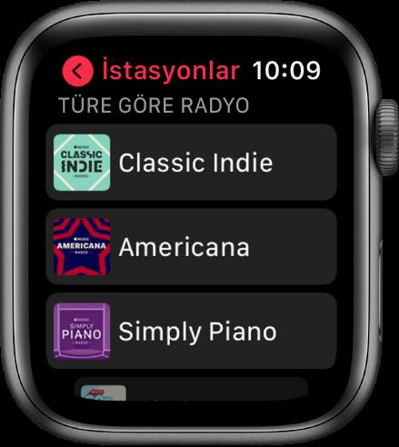 Üç Apple Music Radyo tür istasyonunu gösteren Radyo ekranı.