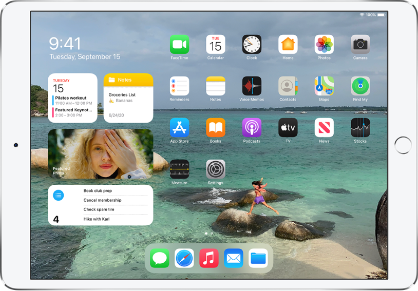 The iPad Home Screen. On the left side of the screen is Today View, showing the Calendar, Notes, Photos, and Reminders widgets. On the right side of the screen are apps.
