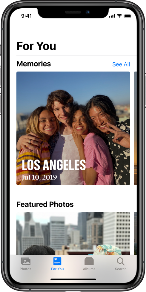 In the Photos app, the For You tab showing the Memories section. The memory has a cover photo that includes the location and date. In the top right of the screen is a See All button, which shows you all your memories.