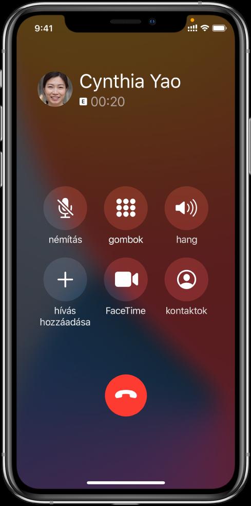 A Telefon alkalmazás képernyője, amelyen a hívás közben rendelkezésre álló opciók gombjai láthatók. A felső sorban balról jobbra a némítás, a gombok és hangszóró gombjai láthatók. Az alsó sorban balról jobbra a híváshozzáadás, a FaceTime és a kontaktok gombjai találhatók.