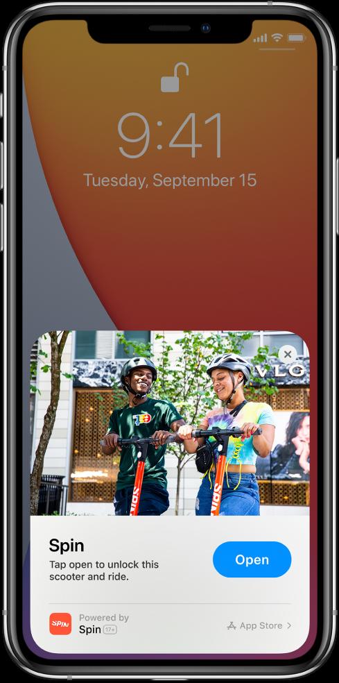 """""""App Clip"""", rodoma """"iPhone"""" užrakinimo ekrano apačioje."""