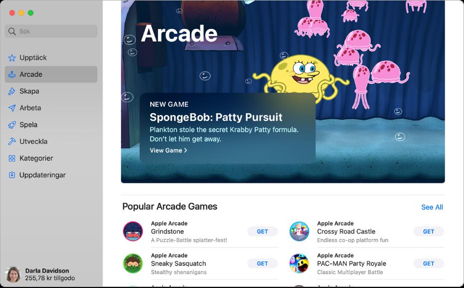 Huvudsidan för Apple Arcade. Ett populärt spel visas i panelen till höger och andra tillgängliga spel visas nedanför.