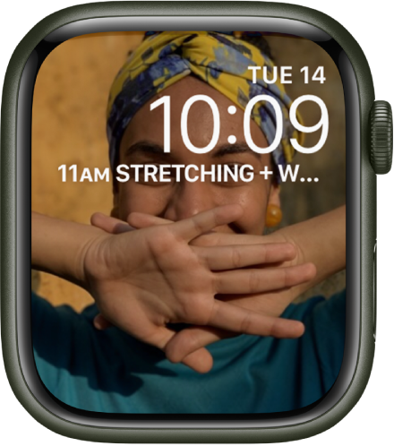 The Photos watch face shows a photo from your synced photo album. The date and time is near the top right, and a Calendar Schedule complication is below.