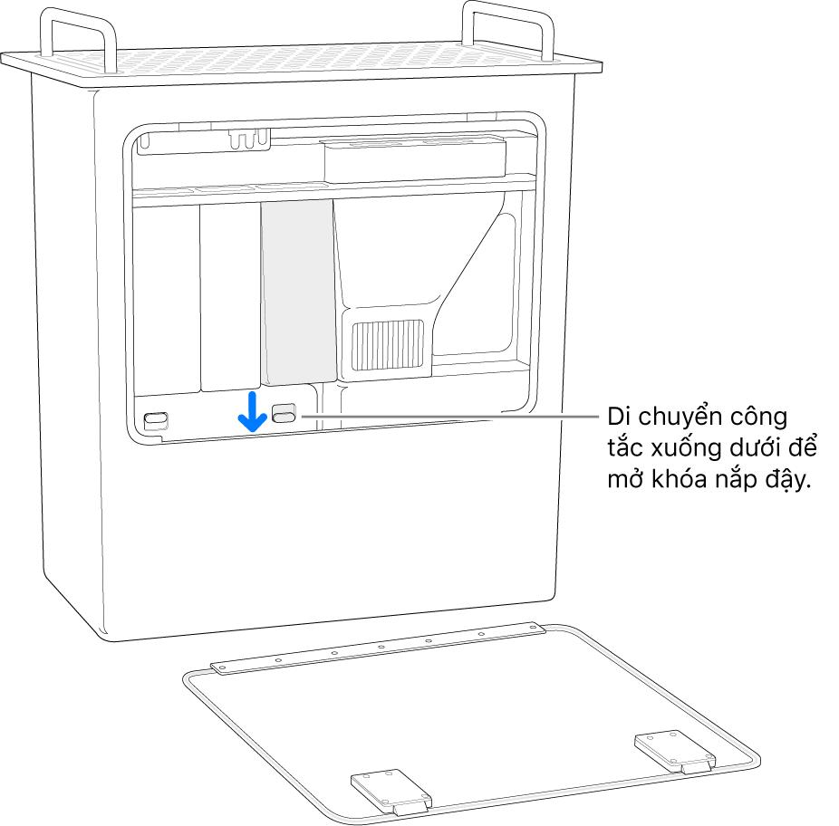 Mac Pro đang được đặt vào đúng vị trí, đang tô sáng công tắc mở nắp DIMM.