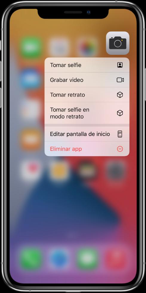 La pantalla de inicio difuminada, mostrando el menú de acciones rápidas de Cámara, debajo de la app Cámara.
