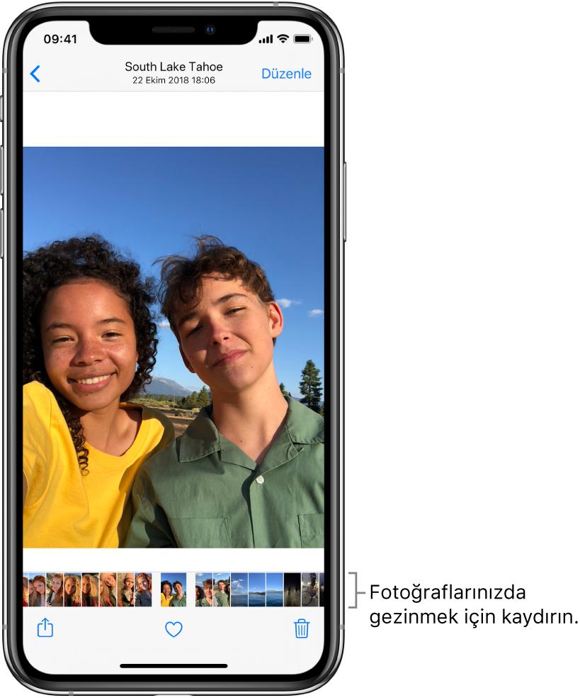 Bir fotoğraf. Ekranın en altında diğer fotoğrafların küçük resimleri var. Sol üstte, fotoğraflara göz attığınız görünüme dönmenizi sağlayan geri düğmesi bulunuyor. En altta Paylaş, Beğen ve Sil düğmeleri var. Sağ üstte Düzenle düğmesi bulunuyor.