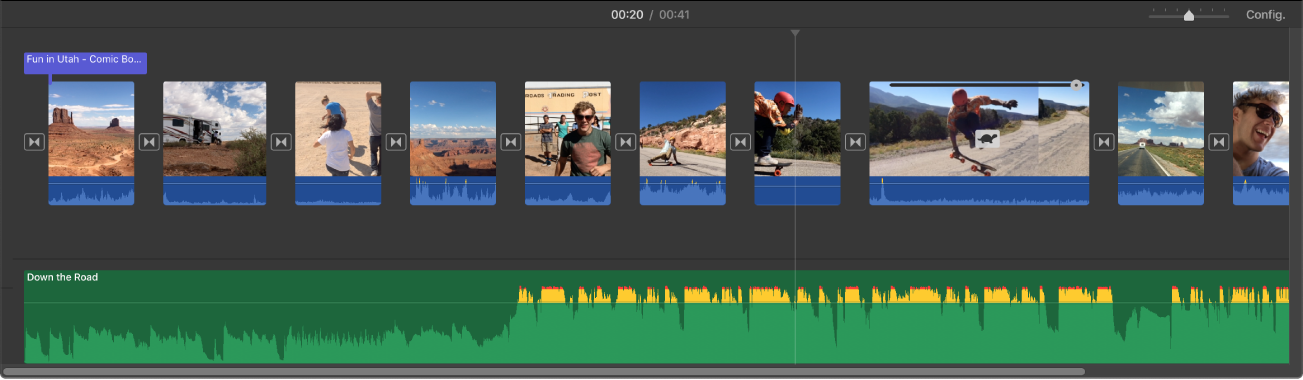 Línia de temps que mostra miniatures de clips de vídeo i un clip d'àudio a sota dels clips de vídeo