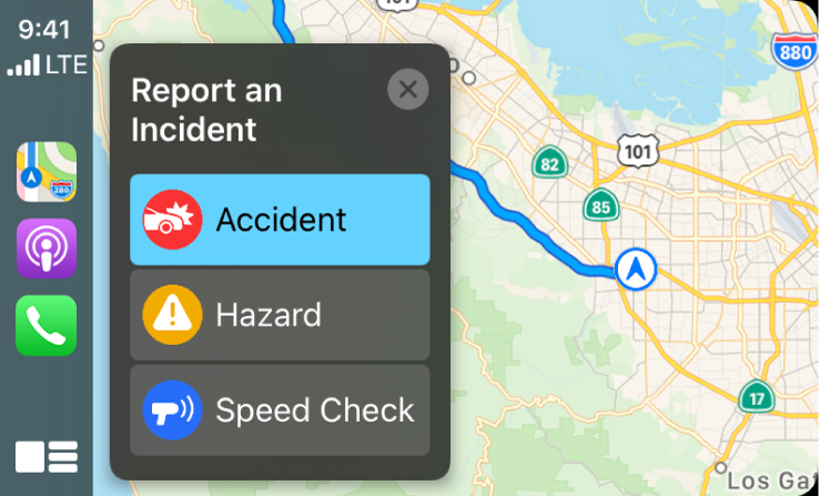 CarPlay showing icons for Maps, Podcasts, and Phone on the left and a map of the current area on the right reporting a Traffic Accident, Hazard, or Speed Check.
