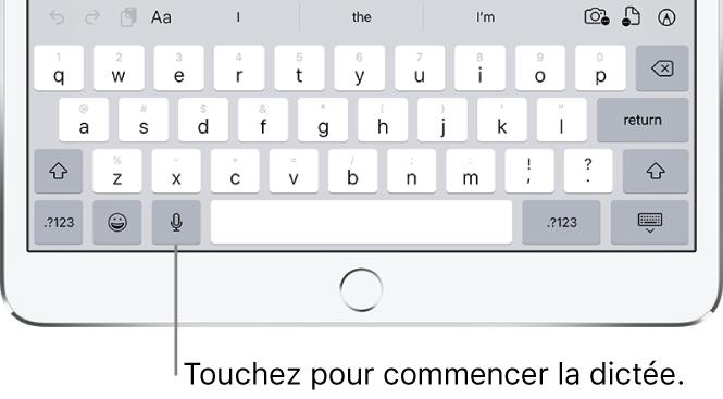 Clavier à l'écran montrant la touche Dicter (à gauche de la barre d'espace), que vous pouvez toucher pour commencer à dicter du texte.