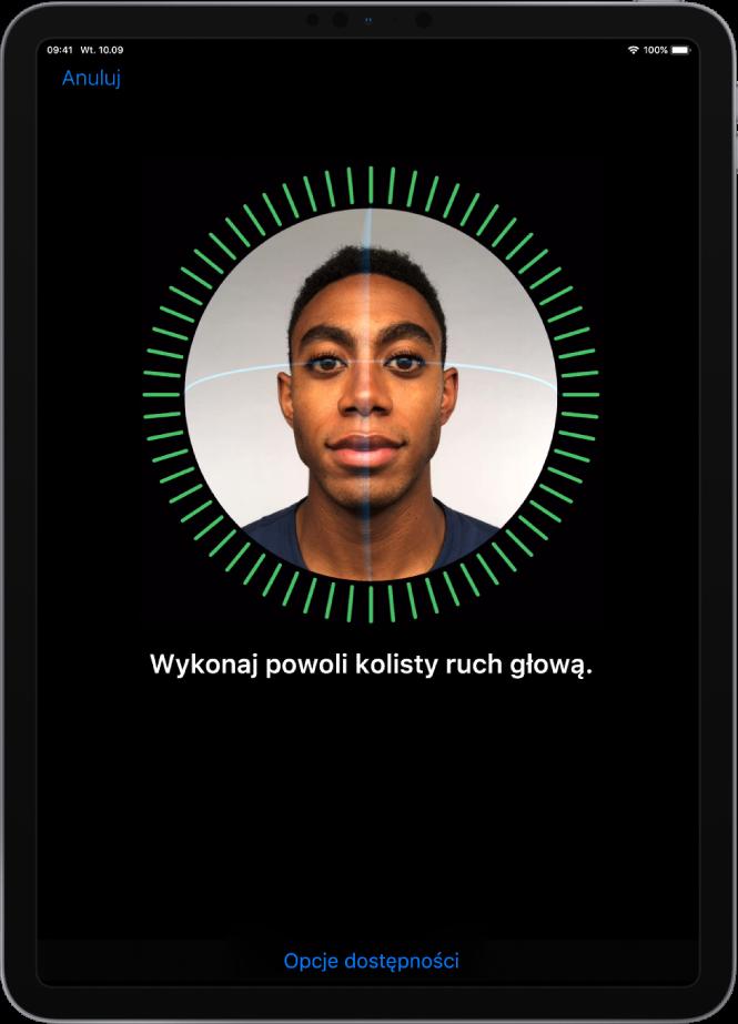 Ekran konfiguracji funkcji FaceID. Na ekranie wyświetlana jest twarz otoczona okrągłą ramką. Poniżej znajduje się tekst proszący użytkownika opowolne wykonanie kolistego ruchu głową.