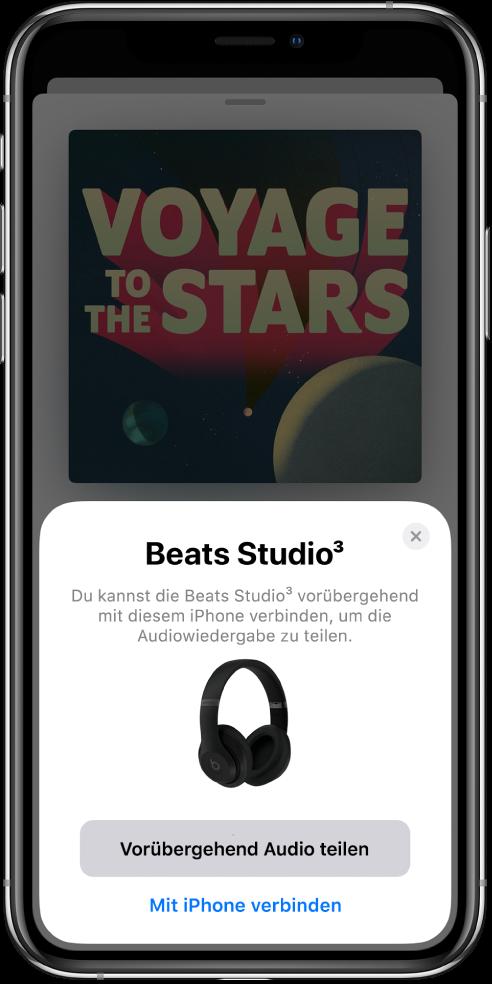 Ein iPhone-Bildschirm mit einer Abbildung von Beats-Kopfhörern. Unten auf dem Bildschirm befindet sich eine Taste zum vorübergehenden Teilen der Audioausgabe.