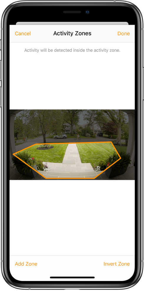 The iPhone screen showing an activity zone within an image taken by a doorbell camera. The activity zone encompasses a front porch and walkway, but excludes the street and driveway. Cancel and Done buttons are above the image. Add Zone and Invert Zone buttons are below.