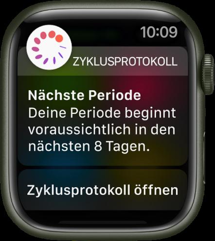 """Apple Watch mit dem Bildschirm für die Vorhersage der Periode, auf dem die Mitteilung """"Nächste Periode. Deine Periode beginnt voraussichtlich in den nächsten 8 Tagen."""" zu sehen ist Unten wird die Taste """"Zyklusprotokoll öffnen"""" angezeigt."""