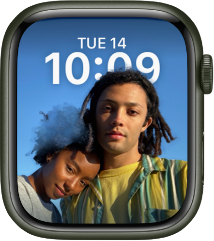 The Portraits watch face shows a photo from your synced photo album. The date and time is at the top.
